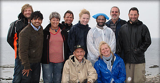 The whole team on location in the rain
